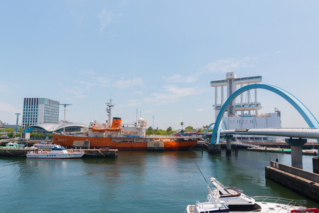wharf: NAGOYA, JAPAN - JUNE 18 2016: The Port of Nagoya, located in Ise Bay, is the largest and busiest trading port in Japan, accounting for about 10% of the total trade value of Japan.