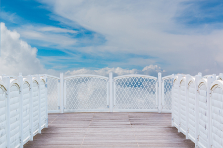 White balcony with perspective wood floor on nature sky background. Standard-Bild