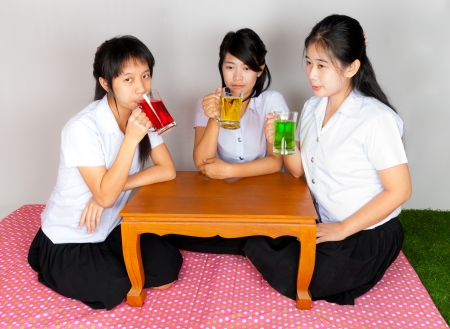 Asian Thai Students drinking colorful soda photo