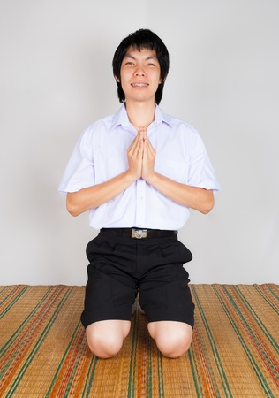 an obeisance: High School Asian Thai Student is paying obeisance Stock Photo