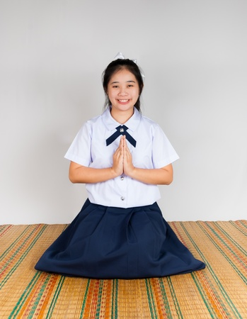 High School Asian Thai Student is paying obeisance photo