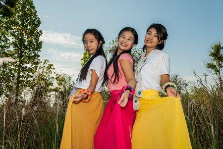 skirts: Asian Thai girls are picking their skirts. Stock Photo