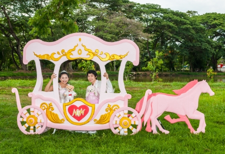 Asian Thai bridal with the wedding teddy bear in romantic carriage with love theme as the Prince and Princess. photo