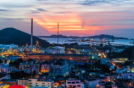 Oil Refinery Factories Beside Seaport st Sunset. photo