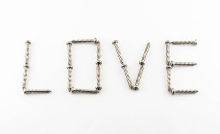 LOVE Word Created by Stainless Steel Screws. photo