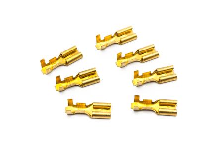 Pile of Gold Crimp Terminal Connectors. photo