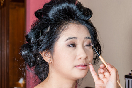 eyelids: Asian Thai Girl Getting Eye Shadow on Eyelids.