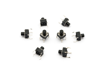 at tact: Pile of Tact Switches.