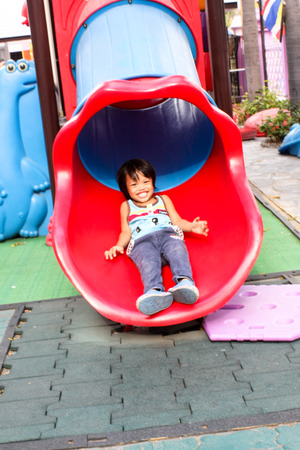 Children having fun in the playground Stock Photo