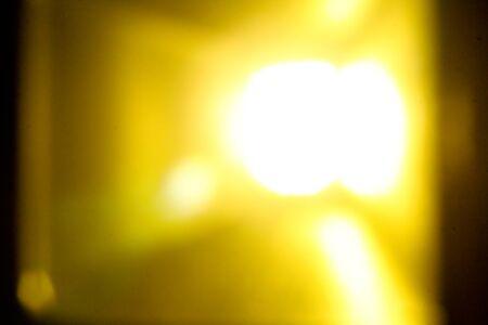 dazzlingly: blur image yellow spot Light Background Stock Photo