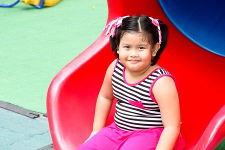 bambino: Children having fun in the playground Stock Photo