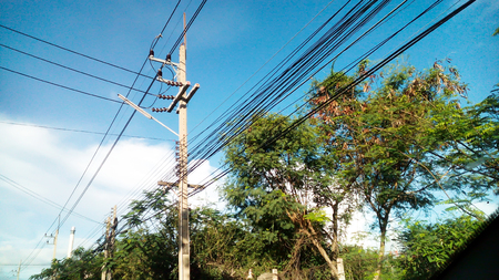power cables: electricity post by the road with power line cables