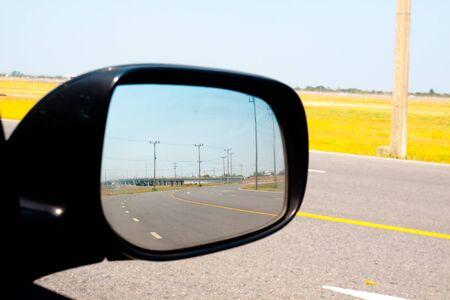 looking behind: looking behind by auto car side mirror