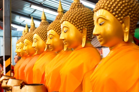 Golden Buddha statues at the temple in Thailand