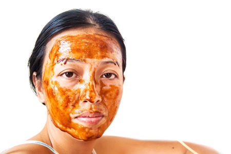 Skin care. Woman in clay mud mask on face isolated on white. Girl taking care of dry complexion. Beauty treatment.Skin care. Woman in clay mud mask on face isolated on white. Girl taking care of dry complexion. Beauty treatment.