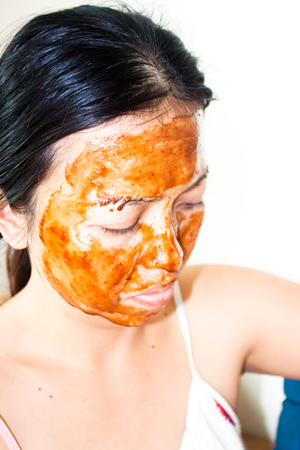 mud girl: Skin care. Woman in clay mud mask on face isolated on white. Girl taking care of dry complexion. Beauty treatment.Skin care. Woman in clay mud mask on face isolated on white. Girl taking care of dry complexion. Beauty treatment.