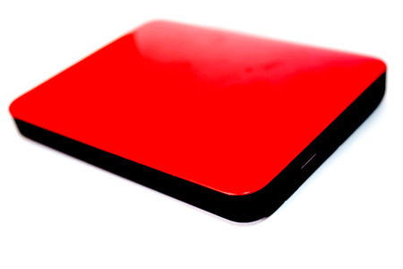 hard disk: External hard disk drive on red case isolated on the white background