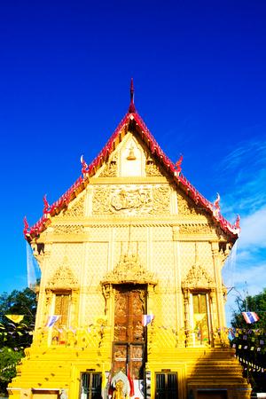 Golden temple landmark of Wat Pra Sri Arn against blue sky in Photharam Ratchaburi Province, Thailand Stock Photo