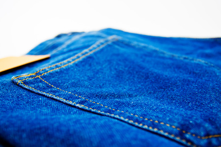 washed: blue jeans back pocket isolated on the white background Foto de archivo