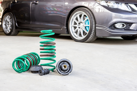 Spring suspension with seal rubber part and blur car background for texture and copy space service concept Stock Photo