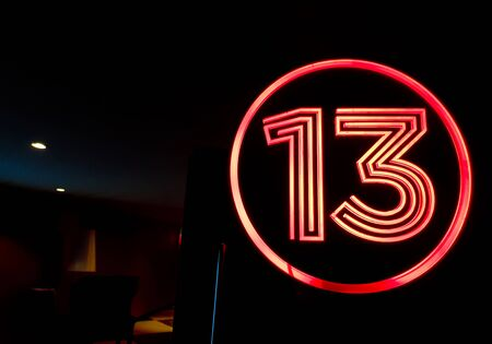 Lucky Number 13 On the red light sign Top of the cinema door 스톡 콘텐츠