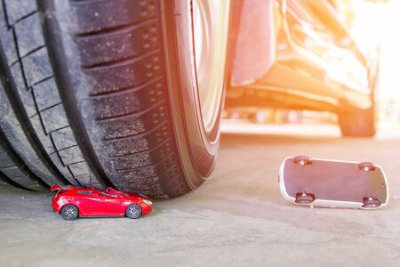 Toy car accident concept with wheel of car toy car broken on cement floor