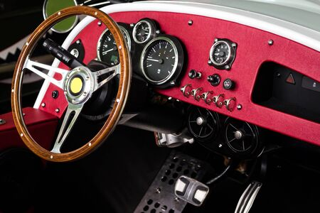 Close up steering wheel of classic car and in side car in the motor show hall
