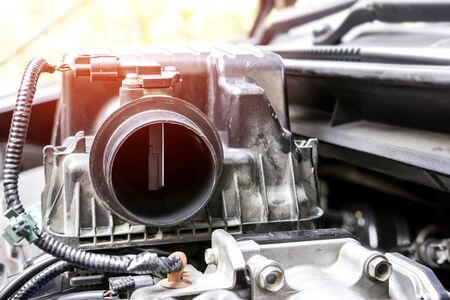 Close up air flow or Oxygen sensor of car with air filter in engine room service concept