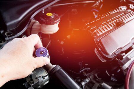Close up and Technician setting plug of Air refill kit for car repair air  condition maintenance concept in car repair shop  Reklamní fotografie