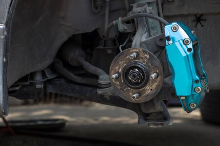 Brake caliper and old bearing of car check maintenance and change brake pad car service concept in shop