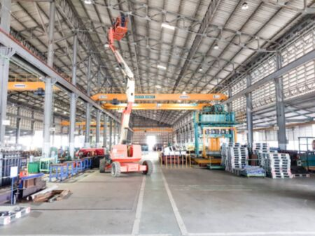 Blur photo of factory use Boom Lift car Work on high repair roof and check structure for industrial work