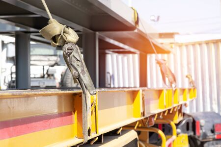 Ratchet Strap for fastening products to prevent falling on the truck with transportation work Banque d'images