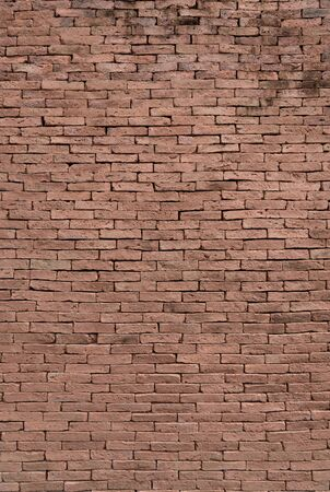 Vertical view of Red brick and old cement surface for background and texture