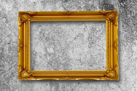 gold picture frame: Old gold picture frame on grunge wall.