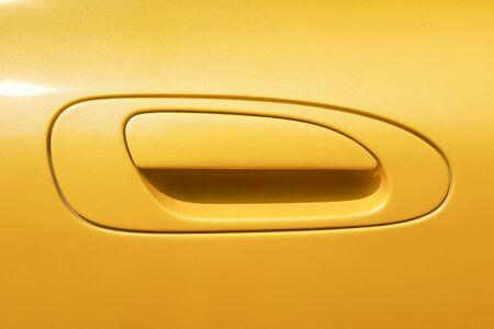 door handle: Yellow Car door handle