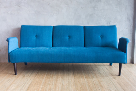 Interior of a room with an blue sofa