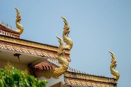 Naga on Lanna Tempel roof Stock Photo