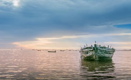abandon: abandon boat in the sea Stock Photo