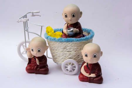 tricycle: little monk doll on tricycle