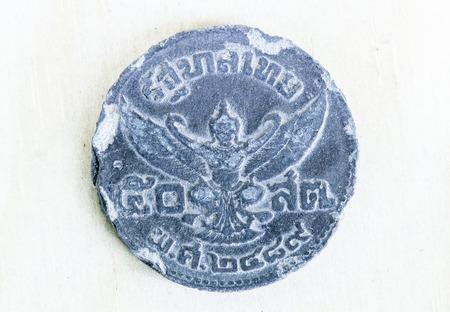 garuda: Rama VIII Tin Coins : King Ananda Mahidol Portrait - Garuda, Thai vintage coin Stock Photo