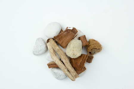 rock, timber, luffa and coconut shell on white background