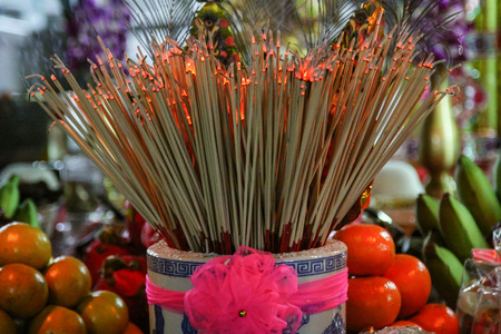 Closeup of the burning incense sticks in Chinese temple, Thailand