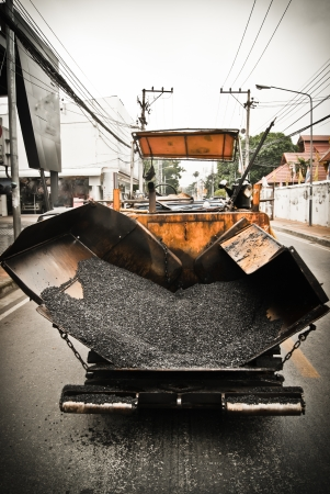 tracked paver at asphalt pavement works for road repairing photo