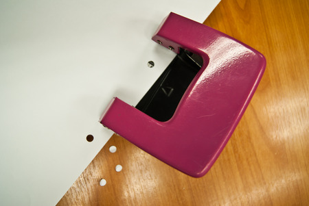Red office hole puncher photo