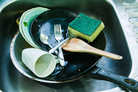 unsanitary: Cups, plates not cleared Stock Photo