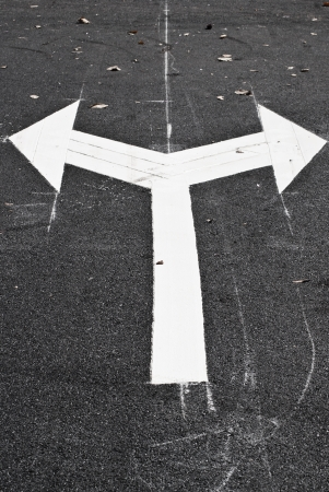 Arrows on the road junction photo