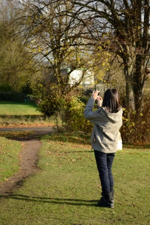 traveler girl taking a photo in the park Stock Photo - 16325976