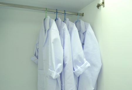 white gown coat hang in the closet