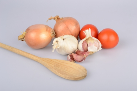 soup spoon: raw ingredients for making soup on white background