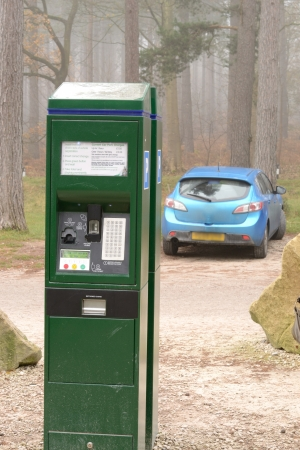 car park machine with blue car in the back